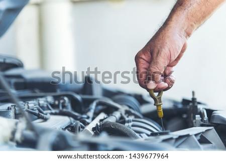 Mechanic man car service repair automobile garage autocar vehicles service mechanical man engineering. Automobile mechanical close up hands fixing car repairs. Mechanic technician workshop center #1439677964