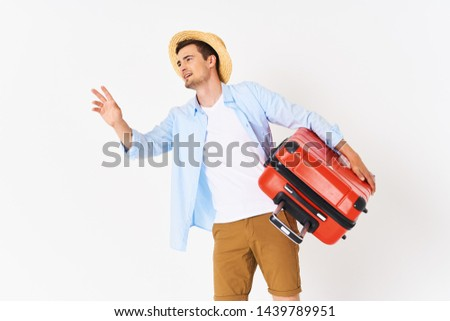 Handsome man with a red suitcase trip flight vacation joy leisure leisure #1439789951
