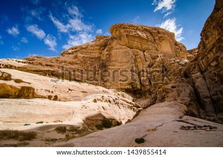 Desert with sandstone and granite rock Wadi Rum in Jordan #1439855414