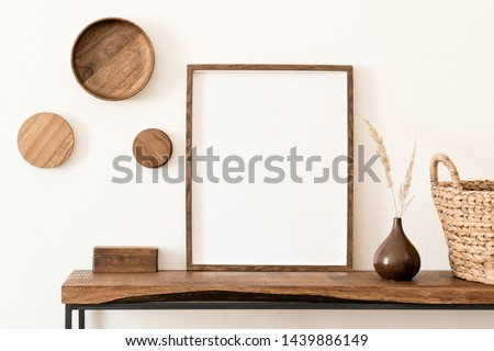 Design scandinavian interior of living room with wooden console, rings on the wall, mock up poster frame and elegant accessories. Stylish composition of home interior. Modern home decor. Template. #1439886149