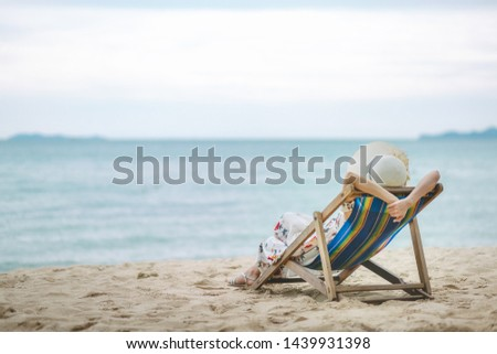 Summer beach vacation concept, Travel asian woman with hat and dress relax on chair beach at Pattaya, Chon Buri, Thailand #1439931398