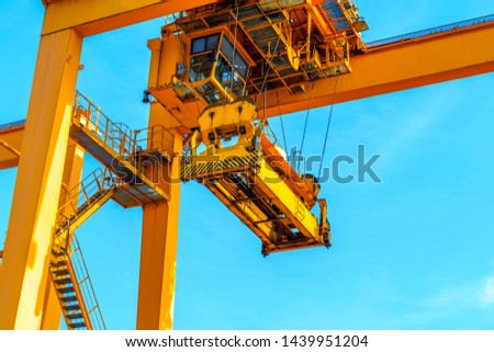 Close up of rubber tried gantry crane at industrial port and container yard import and export containers box in shipping port #1439951204