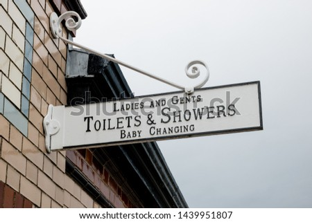 Ornate, vintage toilet and showers sign - public toilets