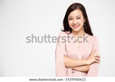 Portrait of successful business asian women in pink dress with arms crossed and smile isolated over white background, Young businesswoman smiling and looking at camera, Happy feeling concept