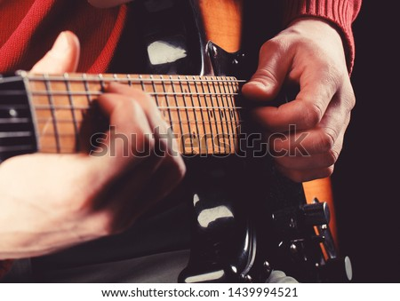 Guitar acoustic. Electric guitar, guitarist, musician rock. Musical instrument. Guitars, strings. Music concept. Play the guitar. Live music. Music festival. Instrument on stage, band.