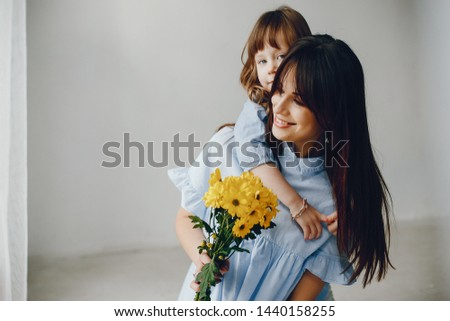 Child give mother flowers. Family at home. Mothers day #1440158255