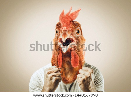 rejoicing cock man. wearing a rooster mask. excited cock. business man and chicken