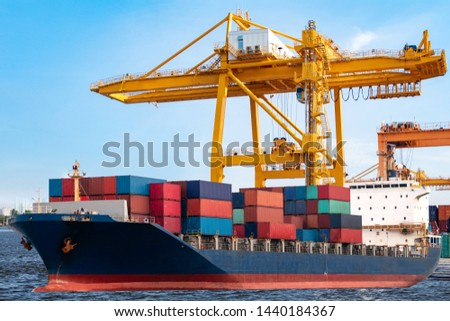 Industrial port crane and container yard import and export containers box in shipping port at industrial port  #1440184367
