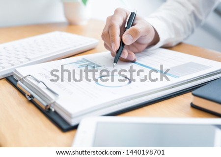 Close-up of hands Businessman reading and writing with pen signing contract over document for Completing Application Form at work in office #1440198701
