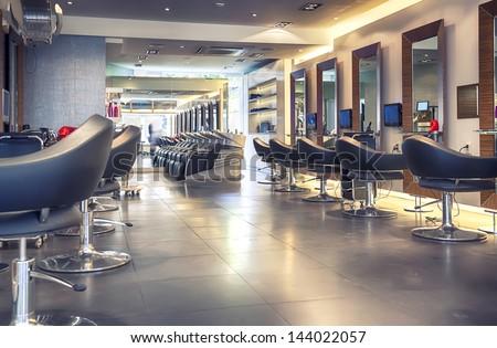 interior of modern hair salon Royalty-Free Stock Photo #144022057