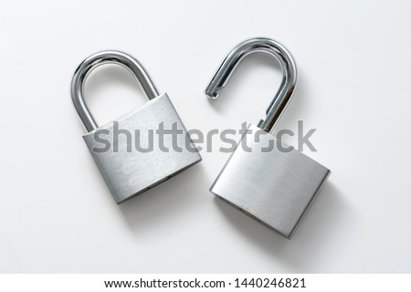 Locked and unlocked silver padlock on the white background. #1440246821