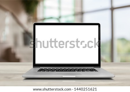 Empty space on wooden Desk with Laptop with blank white screen,In office blurred background of bokeh. - Image          - Image #1440251621