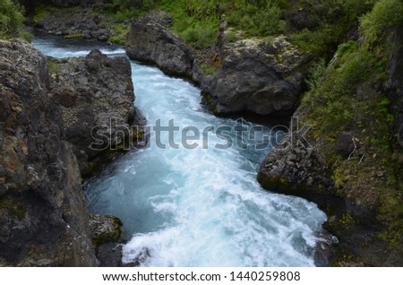 Blue water of a river near Barnafoss in Iceland #1440259808