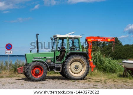 Bogo Denmark - June 30. 2018: Old Fendt tractor with a crane #1440272822
