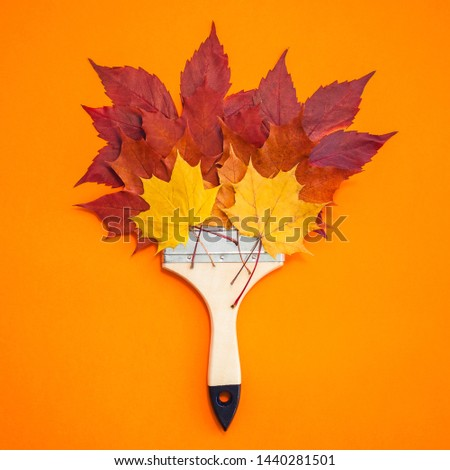 Creative Top view flat lay autumn concept composition. Paint brush dried bright autumn leaves paper background copy space. Square Template mock up fall thanksgiving wedding anniversary invitation card #1440281501