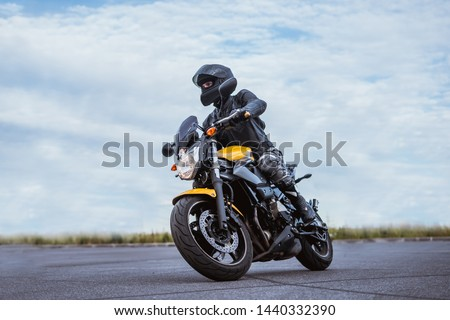 biker rides motorcycle, turns, bright colors motorcycle, sports fast motorcycle #1440332390