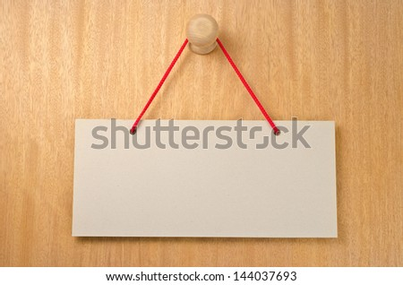 Paper signboard with rope hanging on a handle of door