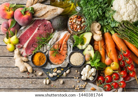 Balanced nutrition concept for clean eating flexitarian mediterranean diet. Assortment of healthy food ingredients for cooking on a kitchen table. Top view flat lay background Royalty-Free Stock Photo #1440381764