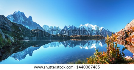 Sunrise  panorama of the Lac Blanc lake with Mont Blanc (Monte Bianco) on background, Chamonix location. Beautiful outdoor scene in Vallon de Berard Nature Reserve, France #1440387485