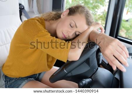 sleepy young woman driving her campvan #1440390914