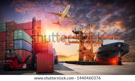 Logistics and transportation of Container Cargo ship and Cargo plane with working crane bridge in shipyard at sunrise, logistic import export and transport industry background #1440460376