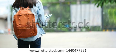 Back to school, Back of college student with backpack while going to university by walking from street, teenager in campus, education background, banner concept