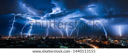 Lightning storm over city in purple light #1440513155