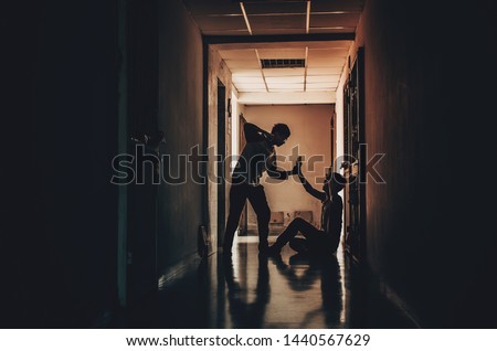 The silhouette of two young men conflict fighting with each other in  the old condo Royalty-Free Stock Photo #1440567629