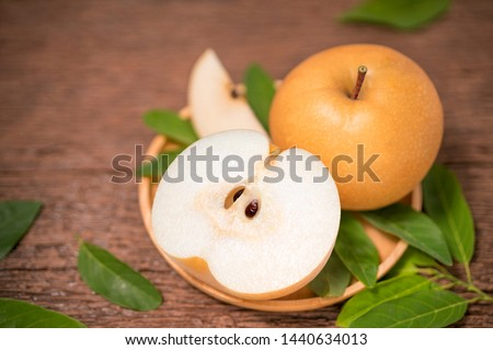 Snow pear or Korean pear on a wooden background, Nashi pear fruits delicious and sweet #1440634013