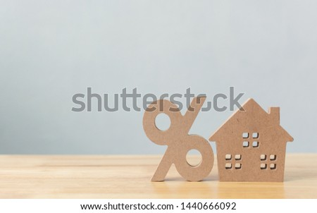 Percentage and house sign symbol icon wooden on wood table with white background #1440666092