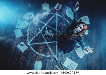 A portrait of a scary witch in the wooden house. Magic, dark force, spell.  #1440670139
