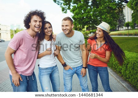 Happy young people in a meeting in the street city #1440681344