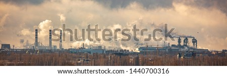 The smoke from the pipes of the metallurgical plant pollutes the environment #1440700316