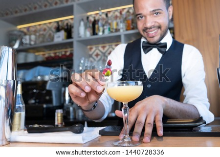 smiling black waite serving a cocktail #1440728336