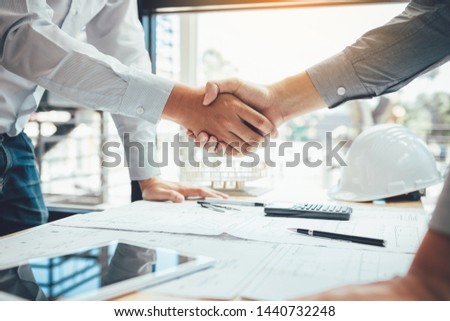 Two engineering man with construction worker greeting a foreman at renovating apartment. #1440732248