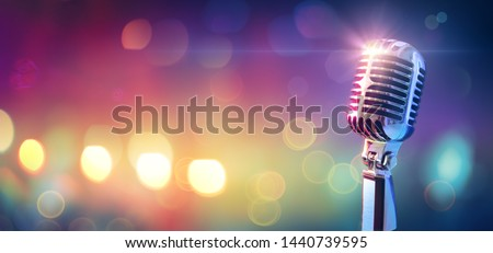 Retro Microphone On Stage With Bokeh Light  #1440739595