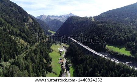 Aerial picture of Brenner Pass in Italian Passo del Brennero is a mountain road through Alps which forms border between Italy and Austria and is one of principal passes of Eastern Alpine range  #1440824252