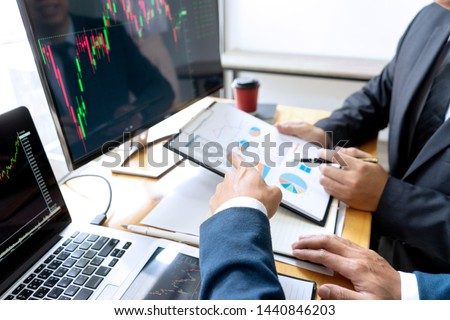 businessman sit at ther table looking at computer laptop in the office , they talking about stock market invest or talk with customer #1440846203