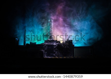Creative artwork decoration. Chernobyl nuclear power plant at night. Layout of abandoned Chernobyl station after nuclear reactor explosion. Selective focus #1440879359