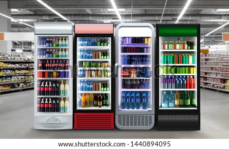 Soda pop drinks and soft drinks in Fridge. Glass door fridge Horizontal photo mockup Soda pop cans and plastic bottles in vertical freezer at supermarket. Suitable for presenting new cans and bottles #1440894095