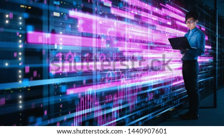 Shot of Asian IT Specialist Using Laptop in Data Center Full of Rack Servers. Concept of High Speed Internet with Pink Neon Visualization Projection of Binary Data Transfer #1440907601