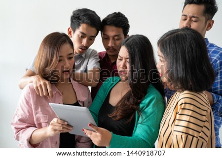 Asian women hold tablets with friends and watch soccer matches #1440918707
