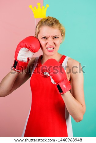 VIP gym. Fighting queen. Woman boxing glove and crown symbol of princess. Queen of sport. Become best in boxing sport. Feminine tender blonde with queen crown wear boxing gloves. Fight for success. #1440968948