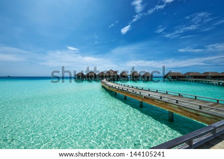 Beautiful beach with water bungalows at Maldives #144105241