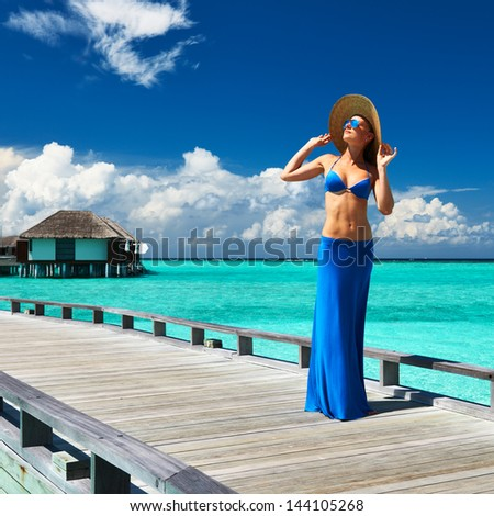 Woman on a tropical beach jetty at Maldives #144105268