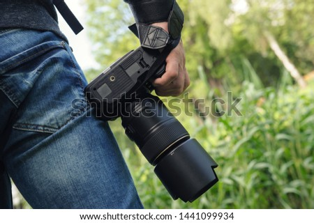 A photographer with the camera. He is ready to take the landscape. #1441099934