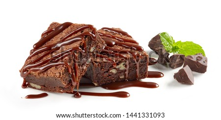 brownie cake pieces with chocolate sauce isolated on white background #1441331093