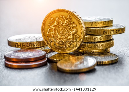 British coins stack on black, pound sterling #1441331129