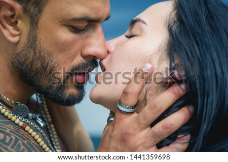 Love story. Beautiful young couple hugging. Love concept. Couple is hugging. Passion love couple. Romantic moment. Muscular man and fit slim young female kissing. Couple goals #1441359698