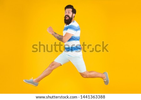 Hurry up. Summer vacation. Man bearded hipster with mustache long beard running yellow background. Guy dressed striped shirt on summer vacation. Barbershop concept. Summer style. Sale and discount. #1441363388